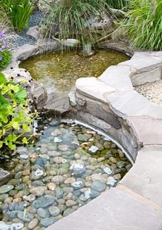 Small ponds with cascading water feature, river rock bottom