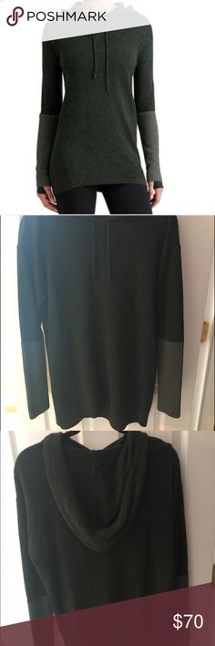 Athelta Merino Nopa Hooded Sweater Athelta Merino Nopa Sweater in Green. Like new condition; only worn once. It is dark green with lighter green cuffs and yoga finger-holes. Very soft and warm, perfect for the winter! Athleta Sweaters V-Necks