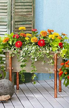 A DIY cedar planter box with cool copper accents hides plant containers and elevates your floral arrangement. A DIY cedar planter box with cool copper accents hides plant containers and elevates your floral arrangement. Container Flowers, Flower Planters, Container Plants, Container Gardening, Plant Containers, Fall Planters, Garden Planters, Cedar Planter Box, Planter Ideas