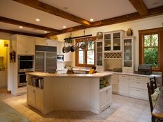 stained windows with white trim | white kitchen with wood stained windows