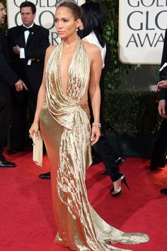 And there's that plunging neckline again! Jennifer showed up at the 2009 Golden Globe Awards looking more like an Oscar statue in her showstopping shiny gold, backless Marchesa gown. Getty / Getty Images -Cosmopolitan.com