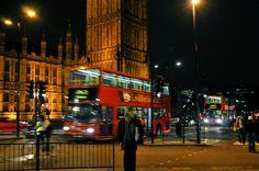 LONDON - DOUBLE DECKER BUS NEAR PARLIAMENT AT NIGHT.