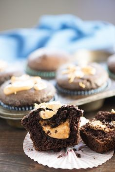 These moist chocolate muffins are filled with a creamy peanut butter center! These are the muffins of my dreams!!