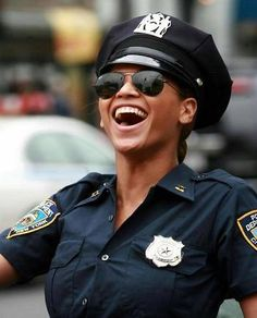 A happy lady cop...
