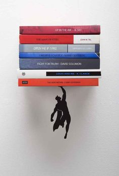 A floating shelf that would be perfect for displaying your comic book collection on.
