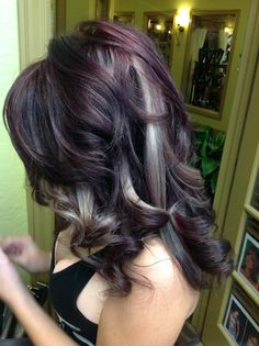 Side view of her deep burgundy red with peek a boo blondes