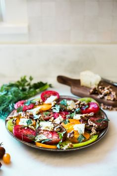 Heirloom Tomato Salad with Toasted Walnuts and Smoked Blue Cheese - a simple summer salad highlightingsweet and juicy heirloom tomatoes. Can be made in 15 minutes!#tomatosalad #tomatowalnutsalad #heirloomtomatosalad #summersalad #farmersmarketsalad #tomatorecipes #walnutsalad Blue Cheese Salad, Tomato Salad Recipes, Farmers Market Recipes, Walnut Recipes, Walnut Salad, Healthy Pastas, Heirloom Tomatoes, Roasted Tomatoes, Summer Salads