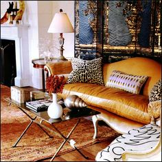 By Bunny Williams-I love the old Oushak capret, leopard pillows and Matisse-like embroidery on the chair