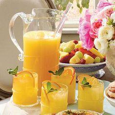 "Sparkling Ginger-Orange Cocktails | Serve Sparkling Ginger-Orange Cocktails at a wedding shower, or try our ""mocktail"" version for moms-to-be at a baby shower. Garnish with orange slices and fresh mint springs. | SouthernLiving.com"