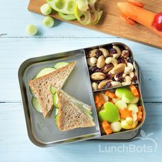 A cucumber sandwich, mixed nuts and dried fruit, and cut veggies make for the perfect on-the-go lunch in our Bento Trio!