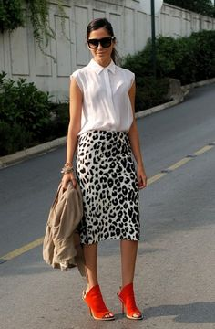 long leopard (printed) skirt, color heels, neutral top with necklace