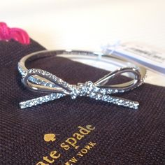 """NWT Kate Spade Pave Bow Bangle Bracelet Gorgeous!!  New with tags. Comes with Kate Spade dustbag. Silver. Measures a diameter of 2.25"""". Matching Kate Spade pave bow earrings also for sale!  NO TRADES kate spade Jewelry Bracelets"""