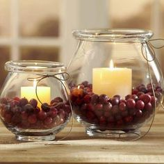 Candles in cranberries.....pretty.