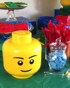 J's 5th Birthday Lego Party: Dessert Table!  We used the Lego head storage bins all over for decorations.
