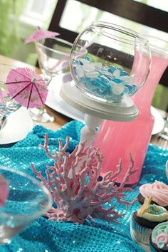 I think filling the fish bowl with candy sharks would be cute!