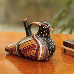 This is a 'Whistling Dove' - it was made by Walter Jose Acosta from Peru.  It's a modern day replica of similar artifacts found in excavations throughout the Andes - it has Nazca origins