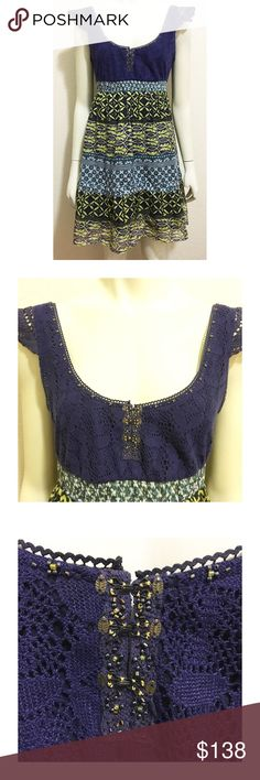 """Free People Size 12 Navy Crochet Bead Accent Dress Excellent used condition dress by Free People. Navy crochet top with beaded neckline, hook and eye front closure, empire waist, and lined, printed skirt. Great print for spring! All beading intact. Exterior is 51% silk/49% cotton. Interior lining is 100% cotton. Length is approximately 34"""", bust (armpit to armpit lying flat) is approximately 17"""". Free People Dresses Mini"""