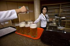 North Korean waitresses prepare to serve beer at the Mansugyo Soft Drink restaurant in Pyongyang, on December 20, 2012.