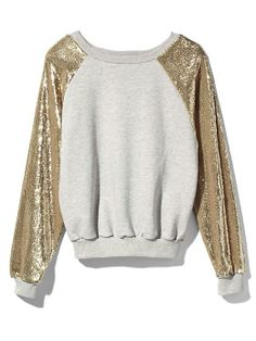 Casual + Chic, a sequin sweatshirt for comfort + party style. Pair with the meSheeky TRIXIE PANT in Jet.