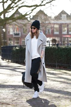 this look : White Crew-neck T-shirt — Grey Coat — Black Sweatpants — Black Beanie — Black Leather Backpack — White Athletic Shoes — Gold Watch — Black Leopard Sunglasses Looks Street Style, Looks Style, Mode Outfits, Casual Outfits, Sporty Chic Outfits, Sporty Chic Style, Trendy Style, Women's Casual, Best Winter Coats