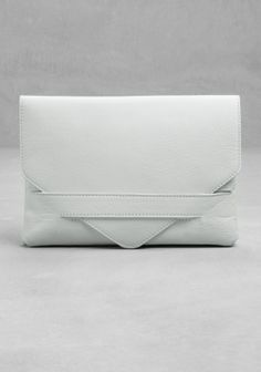 & OTHER STORIES, white leather clutch - so simple, but a great statement in…
