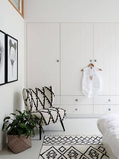 Adding a statement piece, like this gorgeous chair, will contribute depth to your design without any chaos-inducing clutter, making it a no-fuss solution to achieving a high-end minimalist