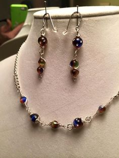 See Shop for Coupons  18 inch Sterling plated curb chain with Multicolored Glass bead with crystals wire wrapped with Sterling silver Earrings (set) by PCMRNTREASURESJEWELS on Etsy