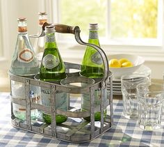 Nice for those that love to entertain   Wine bottle caddy...great way to display all the wines available to your guests  Galvanized Metal 6-Pack Bottle Caddy