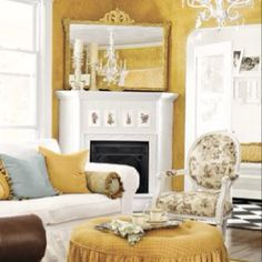 Love the white couch, toile chair and cute ottoman.
