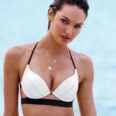 Victoria's Secret Hottie Halter bikini top New without tags: never worn! Size 34DD from Victoria's Secret. Push-up bikini top with padding! Victoria's Secret Swim Bikinis