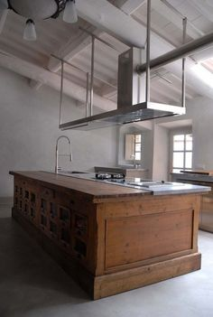 country style island and big stainless steel hood. We have a similar styled island for the cottage coming soon, made out of a hardware store counter.