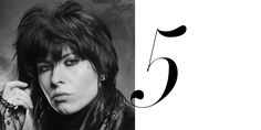 The Pretenders' frontwoman sexes up the shag with lots of smoky black liner. Getty  - HarpersBAZAAR.com