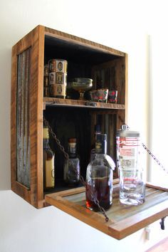 Rustic Hanging Liquor Cabinet - Murphy Bar - Wall Bar - Wine Rack - *FREE Shipping* by inglewoodcrafters on Etsy https://www.etsy.com/listing/189878658/rustic-hanging-liquor-cabinet-murphy-bar