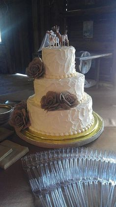 "My daughter's wedding cake with the buck and doe ""topper""."