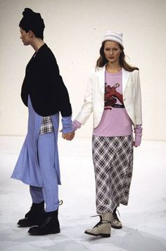 "Kristen McMenamy and Kate Moss model Marc Jacobs  Spring/Summer 1993 'grunge' collection for Perry Ellis . Jacobs described his interpretation of grunge as ""a hippied romantic version of punk."" The collection referenced grunge style with mixed floral and tartan prints and thermal layers... the flannels and thermals were sand-washed Italian silk and cashmere, worn with Doc Martens and specially-made duchesse satin Converse and Birkenstocks."
