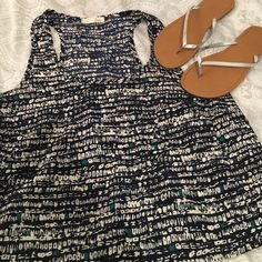 Preparty sale!  Navy patterned tank Really cute tank for summer! Size medium, slightly cropped with pocket on left chest. Great with white jeans! Lush Tops Crop Tops