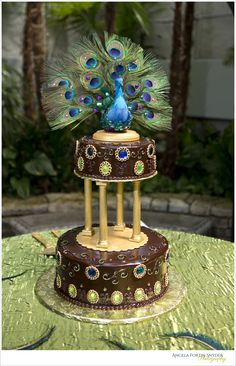 Peacock wedding cake, Chocolate cake with gold embellishments and blue and green jewels!