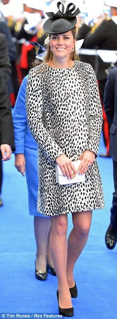 Catherine Middleton looked chic in a dalmatian-print Hobbs coat, Jane Taylor hat, a white box clutch bag and LK Bennett shoes at Southhampton Docks, June 2013