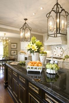 South Shore Decorating Blog: 35 Drool-Worthy Rooms Island display of white with greenery and veggies/fruit on dark countertops.