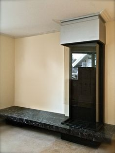 Black stone front cladding and white painted steel hood with big fire resistant glass fireplace Niagara by Virtu  . http://en.fineline.ru/