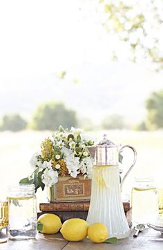 Love the overflow of flowers on top of the books and the lemons. I want lemonade at my wedding with berries to mix in. Ah. It'll be perfect.