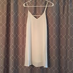 NWOT white spaghetti strap dress with lattice back Super cute white spaghetti strap dress with a deep back and lattice detail. This dress is lined so it's not see through. Perfect condition! Found in a little boutique so not the most mainstream brand, but super adorable! Maddy K Dresses Mini