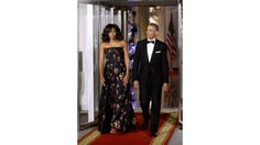 Michelle Obama: First Lady of Style | Bold Shoulder First Lady Michelle Obama stuns again at a Canadian state dinner held at the White House on March 10. In a custom floral-print Jason Wu gown, the bare-shouldered and graceful FLOTUS definitely made a lasting impression. We've got more of her stellar style moments, straight ahead.