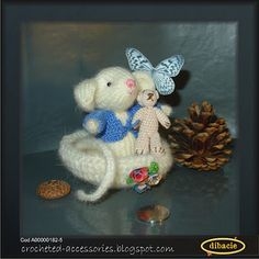 a knitted mouse (about 2 and half inches tall) with a crocheted jacket and teddy bear (about 1 inch tall) in a wool nest - it was a inspired ghift