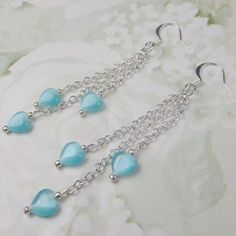 Aqua Cats Eye heart beads in dangle earrings on by beadwizzard