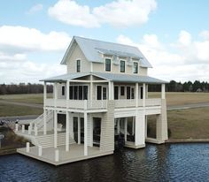 The Boathouse: a new definition to lakefront living! House On Stilts, Boat House, Lakefront Property, Boat Slip, Villa, Rustic Design, Exterior Design, Exterior Angles, Future House
