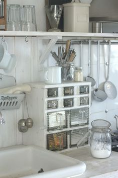 Lovely Shabby Kitchen. I would love to have the lil storage cabinet