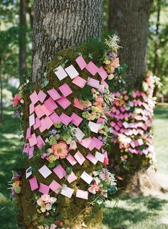 wrap (or pin, no nails) colorful escort cards around a tree