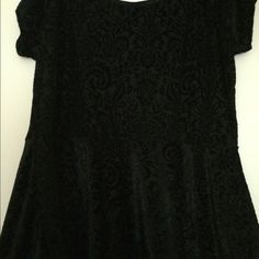 Velvet peplum top This is a super cute velvet peplum top. It's got a cute piece of fabric that looks like bow on the back. I purchased it on another site brand new without tag and it looks to be true I don't see and stains rips of snags. If you have any questions feel free to ask  price is firm torrid Tops