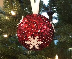 Pins, sequins, foam balls and snowflakes…an ornament makes!  :)  Red!